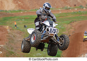 Quad Bike Racing - Quad bike racing, airborne into a corner