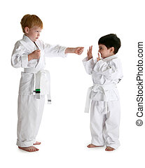 White Belts - Two four year old boys sparing karate moves...