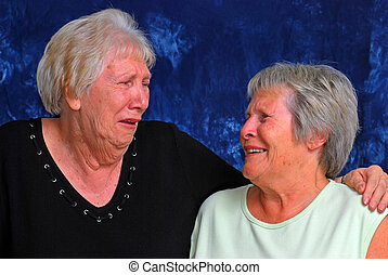 Laughing Sisters with a blue background