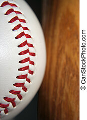 Baseball and bat - A close up of a baseball and bat