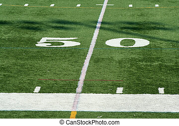 Football fifty yard marke - A white Football fifty yard...