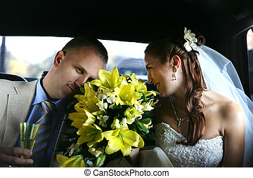 Newly married pair - The groom and the bride with a bouquet...