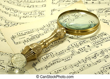 Sheetmusic - Photo of Sheetmusic and a Magnifying Glass