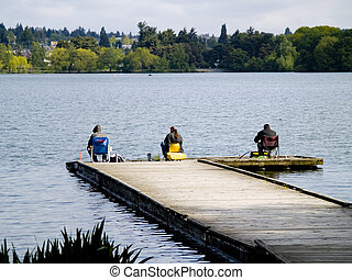 Lake Fishing - Three men fishing on a dock in the park.