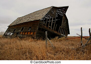 Leaning barn; Alberta - Old barn ready to fall down; cold,...