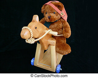 Teddy Ridding Horse - Cool teddy riding his hobby horse on...