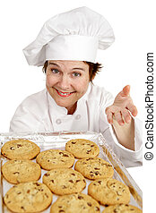 Help Yourself - Pretty chef offering you a tray of freshly...