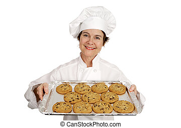 Chef and Chocolate Chip Cookies - Pretty female chef holding...
