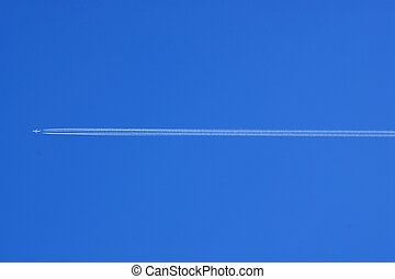 Vapour trail on the blue sky