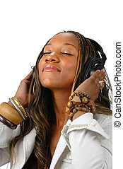 Woman and Music - Young African American enjoying music over...