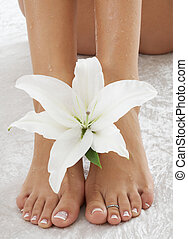 feet with white lily - feet with madonna lily in spa (focus...