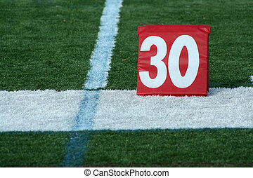 Football thirty yard marker - A red Football thirty yard...