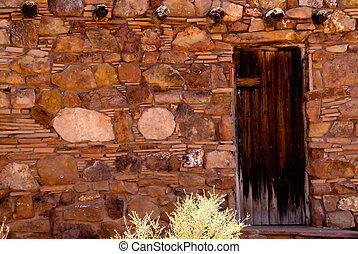Stone shack - Wooden door in an old stone shack can be used...