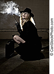 Secret Agent - Beautiful blond woman wearing a black...