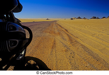 Motorbike in the desert n - Motorbike at the roadside of an...