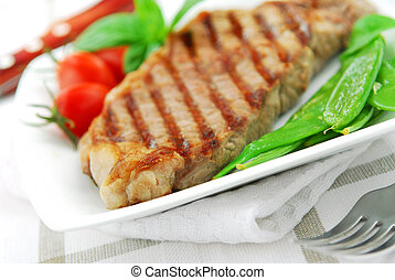 Grilled steak - Grilled New York beef steak served on a...