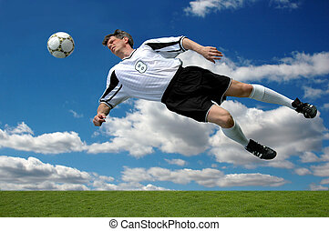 Soccer Action - Soccer player in action shot heading the...