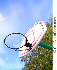 backboard - basketball basket without net against of blue...