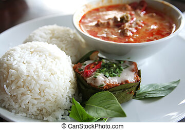 Thai curry - Thai dish of spicy curry steamed fish pudding...