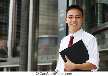 Business man - Good looking asian business man smiling with...