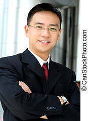 Business man - Good looking asian business man standing with...
