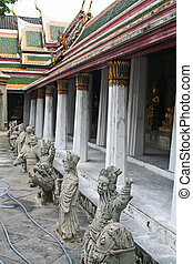 Buddhist statuettes - Deity statuettes in the courtyard of...