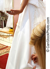 fitting of  wedding dress