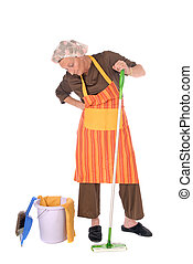 Cleaning housewife - Middle aged housewife with curlers in...