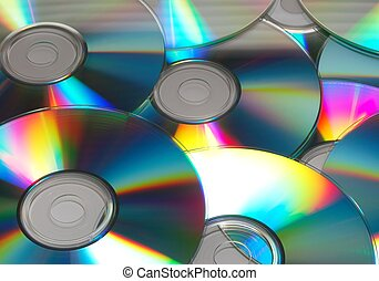 CD\\\'s - Multiple CD\\\'s laying on a table with light...