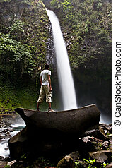 La Fortuna Waterfall - A young man contemplating La Fortuna...