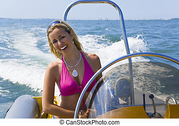 Speedboat Beauty - A stunningly beautiful young woman...