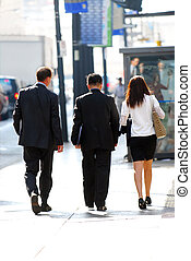 Business people - Business team walking on a sidewalk in...