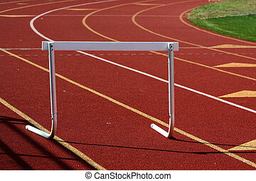 Running track hurdle - A hurdle on a red running track
