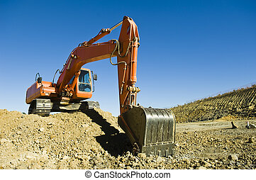 Excavator in a road construction