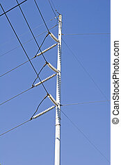 High Power on Blue - A high power electrical pole against...