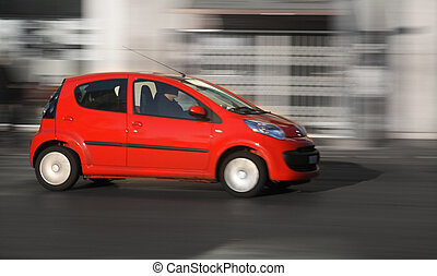 Small Car - Small red generic car speeding in the city....