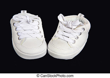 Baby tennis shoes - Pair of white baby tennis shoes on a...