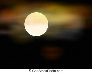 moon glow - A full moon glowing with clouds around it