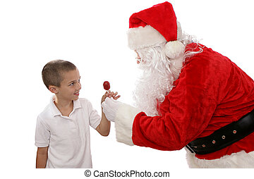 Thank You Santa - Adorable little boy getting a treat from...