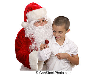 Lolipop From Santa - Adorable little boy sitting on Santas...