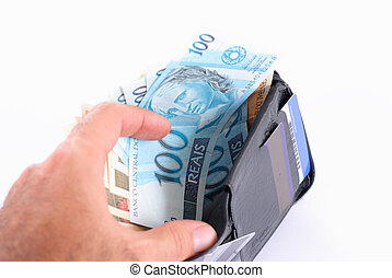 Wallet - Hand opening a leather wallet with money.