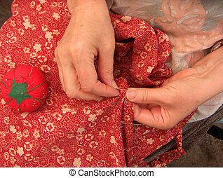 women sewing a hem - stitching a hem in a dress