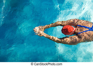 Diving - Athletic swimmer is diving in a swimming pool