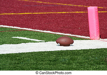 Football end zone with ball - A football near the end zone