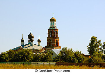 rural church - cupolas and belfry of rural church under...