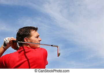 Close up of Iron - Young golfer hitting an iron against a...