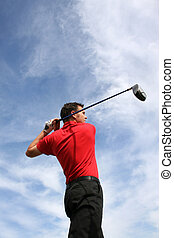 Driving Shot - Young golfer hitting an iron against a half...