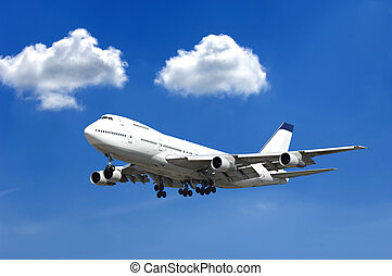 Jumbo plane - Jumbo jet and two clouds on a blue sky