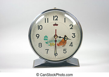 retro alarm clock closeup in white background