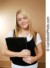 Female holding book - An image of a beautiful female holding...